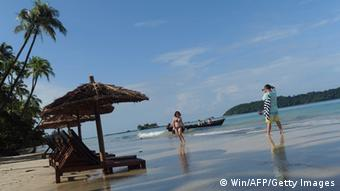 This picture taken on October 4, 2013 shows tourists on the beach in Ngapali, the country's remote major resort near Thandwe, in Myanmar's western Rakhine state.