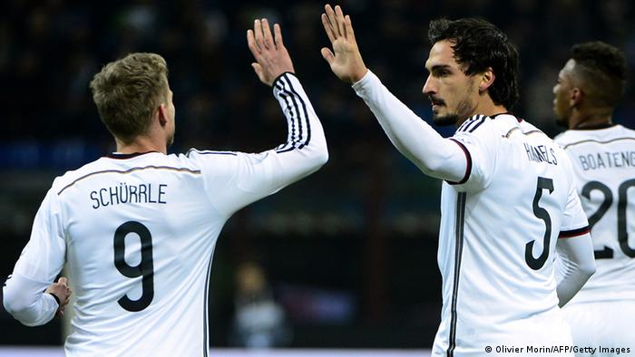 Germany's defender Mats Hummels (R) celebrates with Germany's midfielder Andre Schurrle after scoring during the FIFA World Cup friendly football match Italy vs Germany on November 15, 2013 at the San Siro stadium in Milan. AFP PHOTO / OLIVIER MORIN (Photo credit should read OLIVIER MORIN/AFP/Getty Images)