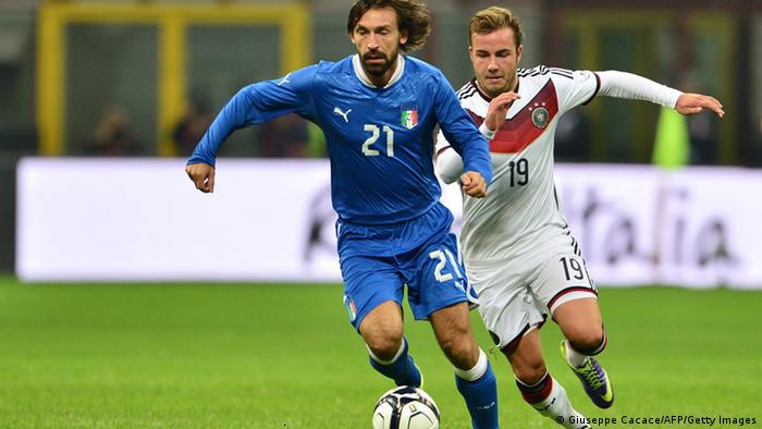 Germany's midfielder Mario Gotze vies for the ball with Italy's midfielder Andrea Pirlo (L) during the FIFA World Cup friendly football match Italy vs Germany on November 15, 2013 at the San Siro stadium in Milan. AFP PHOTO / GIUSEPPE CACACE (Photo credit should read GIUSEPPE CACACE/AFP/Getty Images)