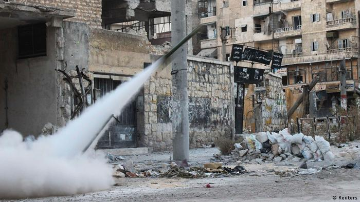 A rocket is fired towards forces loyal to President Bashar al-Assad in Salah al-Din neighbourhood in central Aleppo November 14, 2013. REUTERS/Malek Al Shemali (SYRIA - Tags: POLITICS CIVIL UNREST CONFLICT)