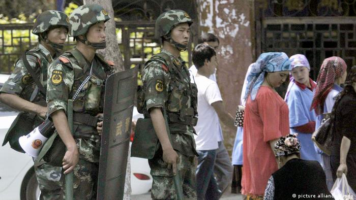 URUMQI, China - Armed police officers guard an area near the international grand bazaar in Urumqi, Xinjiang Uyghur Autonomous Region in China on June 29, 2013. (Kyodo)