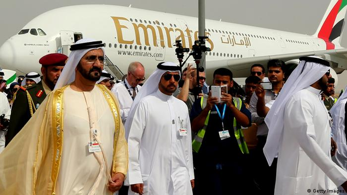 Ruler of Dubai Sheikh Mohammed Bin Rashid al-Maktoum (L) walks past an Emirates Airline's Airbus A380 as he attends the opening ceremony of the Dubai Airshow on November 17, 2013. AFP PHOTO/MARWAN NAAMANI (Photo credit should read MARWAN NAAMANI/AFP/Getty Images)