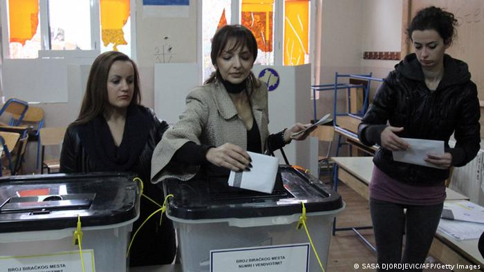 A Kosovo Serb woman casts her ballot on November 17, 2013 at a polling station in the Serb-populated part of the ethnically divided town of Kosovska Mitrovica. (Photo: SASA DJORDJEVIC/AFP/Getty Images)