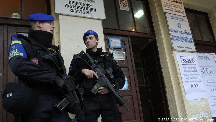 European Union police mission in Kosovo (EULEX) secure on November 17, 2013 the entrance of a polling station in the Serb-populated part of the ethnically divided town of Kosovska Mitrovica. (Photo: SASA DJORDJEVIC/AFP/Getty Images)