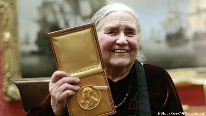British author Doris Lessing shows her prize insignia of the 2007 Nobel Prize in Literature at the Wallace Collection Photo: SHAUN CURRY