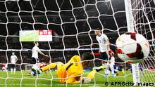 The ball hits the net as England's goalkeeper Fraser Forster dives across the goal during the international friendly football match between England and Chile at Wembley in north London on November 15, 2013. Chile won 2-0. AFP PHOTO / ADRIAN DENNIS -- NOT FOR MARKETING OR ADVERTISING USE / RESTRICTED TO EDITORIAL USE (Photo credit should read ADRIAN DENNIS/AFP/Getty Images)