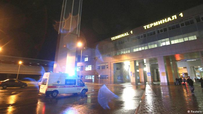 An ambulance is seen outside the main building of Kazan airport November 17, 2013. A Boeing 737-500 airliner crashed on landing in the Russian city of Kazan on Sunday, killing all 50 on board and highlighting the poor safety record of Russian airlines that ply internal routes across the world's largest nation. The Tatarstan airlines flight from Moscow was trying to abort its landing in order to make a second approach, but it exploded on hitting the runway, killing all 44 passengers and six crew on board, emergency officials said. REUTERS/Yegor Aleev (RUSSIA - Tags: DISASTER TRANSPORT)