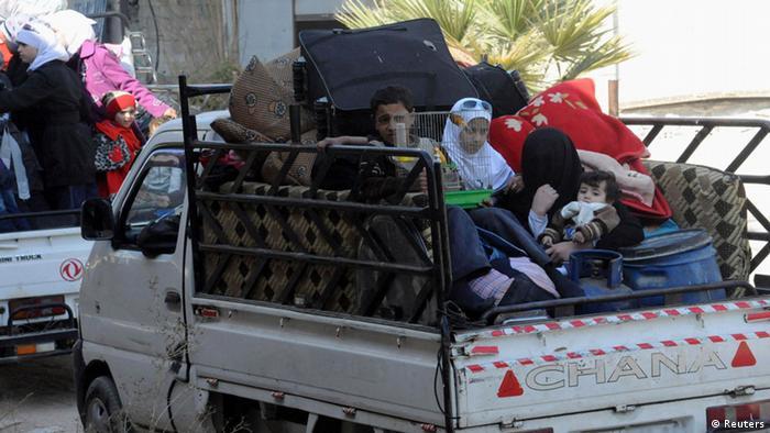 Flüchtlinge auf Autoladefläche (Photo: Reuters)