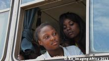 Film scene Virgem Margarida , two women looking out of an open bus window (Re_Imaging Africa 2013)