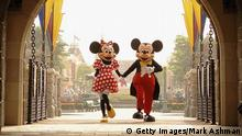 HONG KONG - SEPTEMBER 1: (EDITORIAL USE ONLY) In this handout photo provided by Disney, Mickey and Minnie Mouse are seen walking through Sleeping Beauty Castle at the new Disneyland Park on September 1, 2005 in Hong Kong. The new theme park and vacation resort will officially open September 12. (Photo by Mark Ashman/Disney via Getty Images)