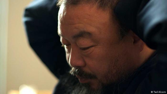 Scene from the film Ai Weiwei: Never Sorry, showing Ai Weiwei looking pensive (Photo: Ted Alcorn. A Sundance Selects release)