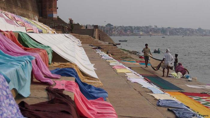 A colourful patchwork of clothes drying in the sun on the banks of the Ganges river in Varanasi, India (Photo: Janak Rogers)