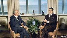 Soviet leader Mikhail Gorbachev and US President Ronald Reagan sit down together inside the Hofdi in Reykjavik, Iceland on Saturday, Oct. 11, 1986 at the start of a series of talks. (AP Photo)/Scott Stewart