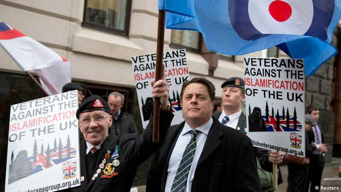 Nick Griffin, chairman of the British National Party, stands with demonstrators protesting outside the Old Bailey courthouse in London. Photo: Reuters