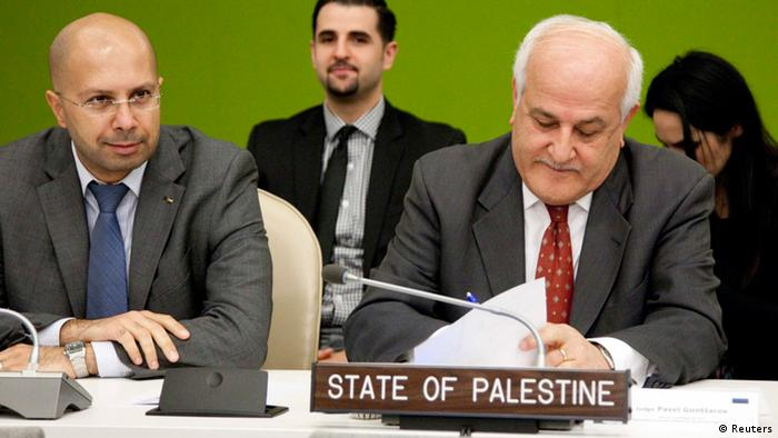Ambassador Riyad Mansour (R), the chief Palestinian UN observer, fills out a ballot for the election of a judge for the International Tribunal for the Former Yugoslavia at the United Nation's headquarters in New York (Photo: REUTERS/ Amanda Voisard/United Nations/Handout)