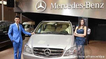 --FILE--Models pose with a Mercedes-Benz Vito car during the 16th Chengdu International Automobile Exhibition in Chengdu, southwest Chinas Sichuan province, 30 August 2013. During the opening of the first engine factory of Mercedes Benz outside of Germany in China, the Chief Xu Heyi of Beijing Automotive (BAIC) said that contracts for a shareholding of Daimler in BAIC would be signed on Tuesday. Daimler would take a sake of 12%.