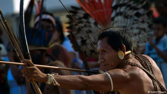 A man holds a cross bow