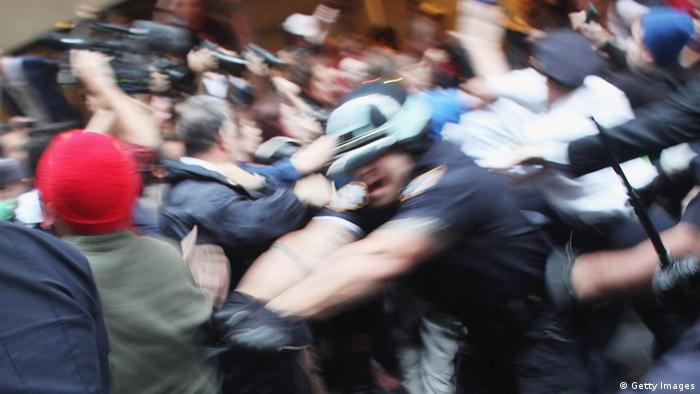 NEW YORK, NY - OCTOBER 14: Police scuffle with members of the Occupy Wall Street movement as they march through the streets of the financial district after the deadline for their removal from a park in the financial district was postponed on October 14, 2011 in New York City. Many of the 'Occupy Wall Street' demonstrators have been living in Zuccotti Park in the Financial District near Wall Street. The activists have been gradually converging on the financial district over the past three weeks to rally against the influence of corporate money in politics among a host of other issues. The protests have begun to attract the attention of major unions and religious groups as the movement continues to grow in influence. Dozens of protesters were arrested in the morning demonstrations. (Photo by Spencer Platt/Getty Images)