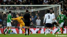 England's goalkeeper Joe Hart (2L) fails to save a goal scored by Germany's Per Mertesacker (R) during their international friendly soccer match at Wembley Stadium in London November 19, 2013. REUTERS/Dylan Martinez (BRITAIN - Tags: SPORT SOCCER TPX IMAGES OF THE DAY)