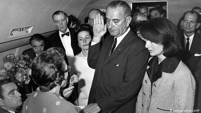 Lyndon B. Johnson being sworn in next to Jackie Kennedy