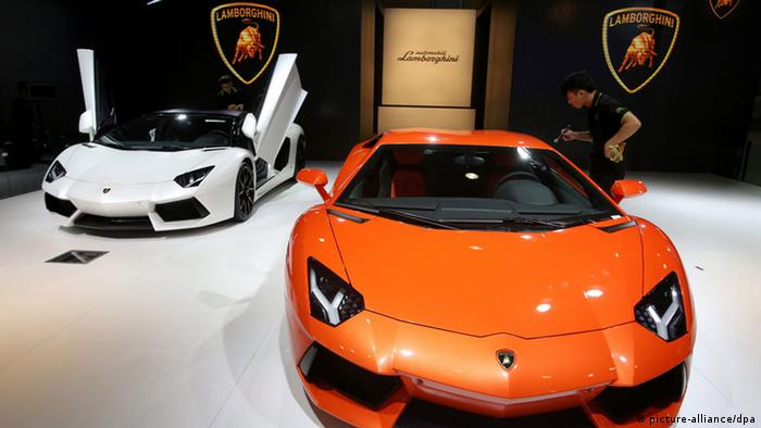 epa03958055 An Aventador LP 700-4 auto of Lamborghini is displayed at the 11th China Guangzhou international automobile exhibition in Guangzhou city, Guangdong province, China, 20 November 2013. The expo will be held from 22 to 30 November in Guangzhou city displaying some 915 autos. EPA/WU HONG
