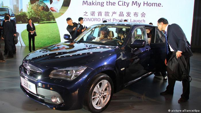 epa03958152 People check out the interior of an electric car Zinoro 1E at its launch during the 11th China Guangzhou international automobile exhibition in Guangzhou city, Guangdong province, China, 20 November 2013. Jointly developed by German car maker BMW and its Chinese partner Brilliance, the e-vehicle can run up to 150 kilometers per charge. Zinoro is also BMW's fourth sub-brand, after BMW, Mini and i. The company will market the e-vehicle on a leasing mode. EPA/Kaifu Zheng CHINA OUT