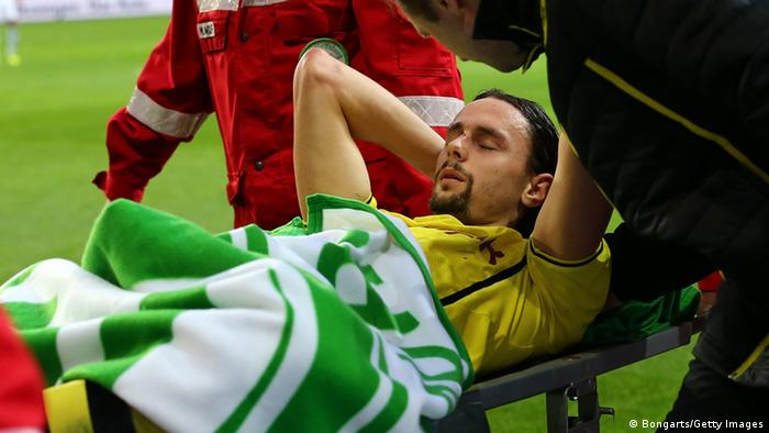 WOLFSBURG, GERMANY - NOVEMBER 09: Neven Subotic of Dortmund is carried injured off the pitch during the Bundesliga match between VfL Wolfsburg and Borussia Dortmund at Volkswagen Arena on November 9, 2013 in Wolfsburg, Germany. (Photo by Martin Rose/Bongarts/Getty Images)