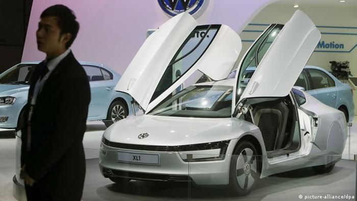 epa03958058 A XL 1 hyper-efficient plug-in diesel hybrid auto of Volkswagen is displayed at the 11th China Guangzhou international automobile exhibition in Guangzhou city, Guangdong province, China, 20 November 2013. The expo will be held from 22 to 30 November in Guangzhou city displaying some 915 autos. EPA/WU HONG
