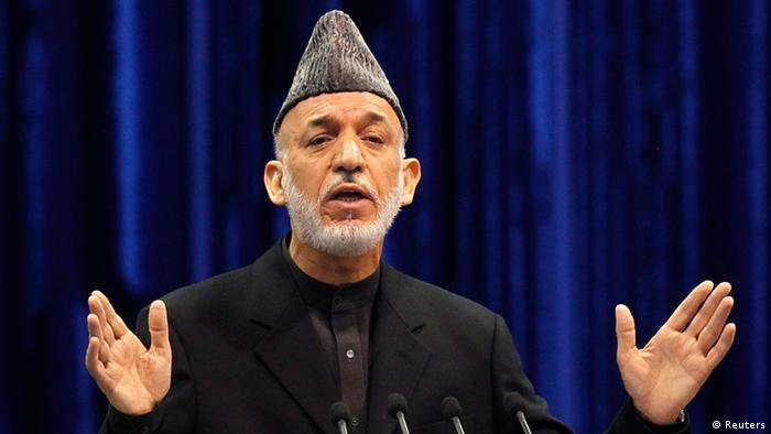 Afghan President Hamid Karzai speaks during the opening of the Loya Jirga, in Kabul November 21, 2013. Karzai told a meeting of tribal elders and political leaders on Thursday they should support a vital security pact with the United States, but acknowledged there was little trust between the two nations. REUTERS/Omar Sobhani (AFGHANISTAN - Tags: POLITICS)