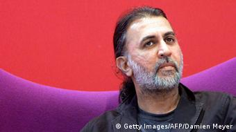 Paris, FRANCE: Indian writer Tarun Tejpal gives a speech at the 27th Paris Book Fair, 23 March 2007, on the eve of its opening. More than 2.000 authors are expected to meet visitors during this five-day fair. With Indian writers reaping awards and topping best-seller lists worldwide, the Paris book fair is putting the spotlight on the country's literary output at this year's edition of its annual fair. AFP PHOTO DAMIEN MEYER (Photo credit should read DAMIEN MEYER/AFP/Getty Images)