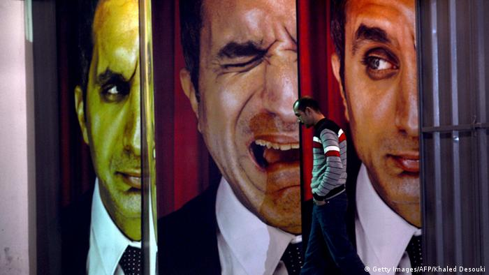An Egyptian walks past posters of Egyptian satirist Bassem Youssef outside a theater in Cairo (Photo: KHALED DESOUKI/AFP/Getty Images)