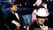 Image #: 25618345 Texas Governor John Connally (foreground) adjusts his tie as President John F. Kennedy and his wife, Jackie, prepare for their tour of Dallas, November 22, 1963. The President would later be shot and killed while his motorcade made its way through Dealey Plaza. This Friday will mark the 50th anniversary of the assassination of President Kennedy on November 22, 1963. UPI/Files /LANDOV /eingest. sc