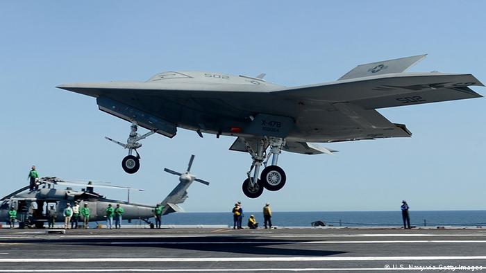 ATLANTIC OCEAN - MAY 17: In this image provided by the U.S. Navy, an X-47B unmanned combat air system (UCAS) demonstrator performs a touch and go landing May 17, 2013 on the flight deck of the aircraft carrier USS George H.W. Bush (CVN 77) in the Atlantic Ocean. This is the first time any unmanned aircraft has completed a touch and go landing at sea. George H.W. Bush is conducting training operations in the Atlantic Ocean. (Photo by Mass Communication Specialist 2nd Class Timothy Walter/U.S. Navy via Getty Images)
