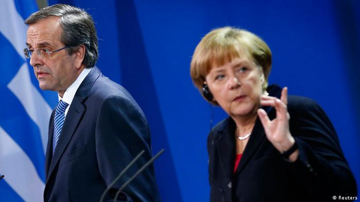 German Chancellor Angela Merkel and Greece's Prime Minister Antonis Samaras attend a news conference after talks at the Chancellery in Berlin, November 22, 2013. Photo: Reuters