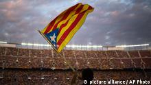 In this photo taken on June. 29, 2013, supporters wave their estelada flags as they attend to a pro-independence festival in the Nou Camp stadium in Barcelona, Spain. The Spanish region of Catalonia is set to see possibly its largest ever pro-independence rally on Wednesday when organizers are hoping to surpass the around one million people who took to streets of Barcelona last year, many of whom called for a free state. Besides the traditional march in Barcelona held on the regional holiday of Sept. 11, a pro-independence grass roots group has organized a human chain stretching for over 400 kilometers north and south across the economically powerful northeastern region. (AP Photo/Emilio Morenatti)