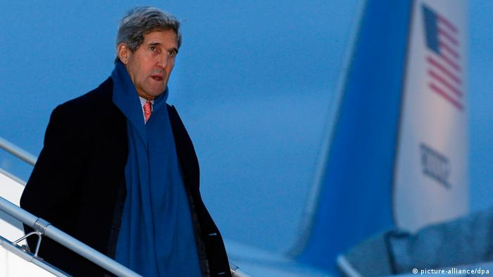 US Secretary of State John Kerry, wearing winter clothing, descends from an official US government jumbo jet