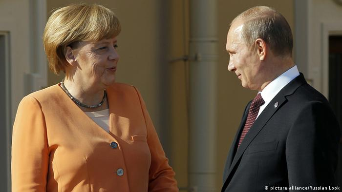 Merkel speaking with Putin