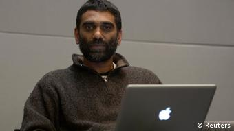 Kumi Naidoo, International Director of Greenpeace (C) uses a laptop computer before the proclamation of sentence at the International Tribunal for the Law of the Sea (ITLOS) in Hamburg, November 22, 2013.An international maritime tribunal on Friday ordered Russia to release a Greenpeace ship and 30 people arrested in a protest against Russian Arctic oil drilling. The Netherlands asked the Maritime Court to order Russia to release 30 Greenpeace activists , which were involved in the September 18 protest against Russia's first offshore Arctic oil rig. The Netherlands also wants Russia to release the activists' Dutch-flagged vessel Arctic Sunrise. REUTERS/Fabian Bimmer (GERMANY - Tags: CRIME LAW ENVIRONMENT POLITICS)