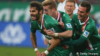 Halil Altintop of Augsburg celebrates sthe opening goal