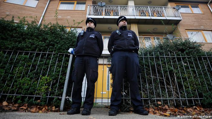 epa03962493 Police officers stand guard in front of a property in Brixton, Borough of Lambeth, south London, Britain, 23 November 2013. Two people who allegedly held three women as slaves in their south London home for more than 30 years had been arrested previously in the 1970s, police said 23 November, but would not say why. EPA/FACUNDO ARRIZABALAGA