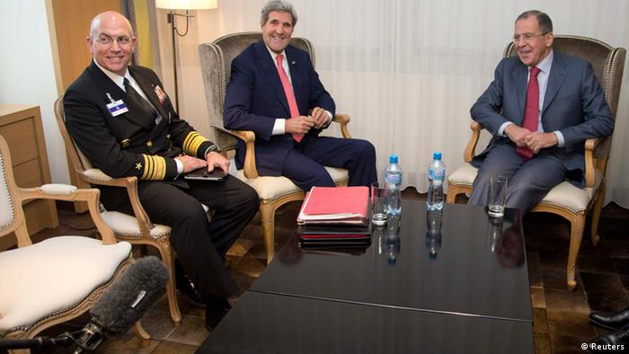 (L to R) Vice Admiral Kurt Tidd, U.S. Secretary of State John Kerry and Russia's Foreign Minister Sergei Lavrov look to a boom microphone held by a member of the media, lower left corner, as they sit together during a photo opportunity at a meeting in Geneva November 23, 2013. Kerry and foreign ministers of five other world powers joined talks on Iran's contested nuclear programme on Saturday with the two sides edging towards a breakthrough to ease a dangerous decade-old standoff. REUTERS/Carolyn Kaster/Pool (SWITZERLAND - Tags: POLITICS MILITARY)