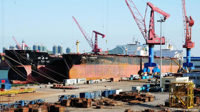 This photo taken on October 17, 2011 shows ships waiting to be loaded at the harbour in Qingdao, in northeast China's Shandong province. China said its economy grew at a slower pace in the third quarter as government efforts to tame inflation and turbulence in Europe and the United States curbed business activity, as gross domestic product in the world's second-largest economy grew 9.1 percent year-on-year in the quarter, the National Bureau of Statistics (NBS) said, compared with a 9.5 percent year-on-year expansion in the second quarter. CHINA OUT AFP PHOTO (Photo credit should read STR/AFP/Getty Images)