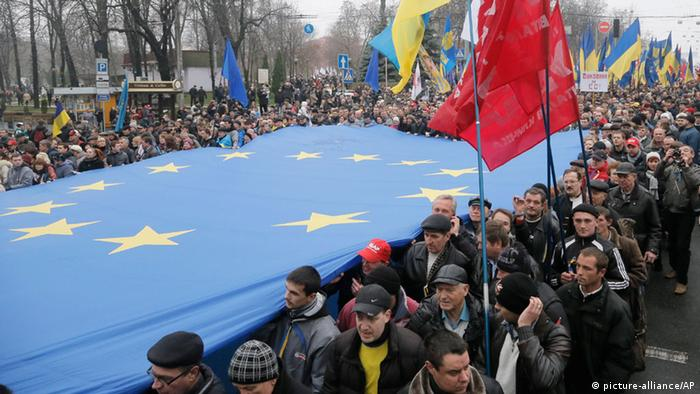 Tens of thousands of demonstrators march and carry EU flags to demand that the Ukrainian government reverse course and sign a landmark agreement with the European Union in defiance of Russia, in Kiev, Ukraine, Sunday, Nov. 24, 2013. The protest was the biggest Ukraine has seen since the peaceful 2004 Orange Revolution, which overturned a fraudulent presidential election result and brought a Western-leaning government to power. (AP Photo/Efrem Lukatsky)