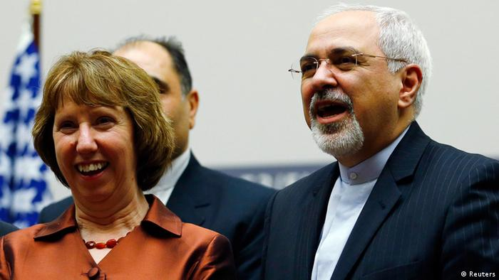 European Union foreign policy chief Catherine Ashton (L) smiles next to Iranian Foreign Minister Mohammad Javad Zarif during a ceremony at the United Nations in Geneva November 24, 2013. Iran and six world powers reached a breakthrough agreement early on Sunday to curb Tehran's nuclear programme in exchange for limited sanctions relief, in a first step towards resolving a dangerous decade-old standoff. REUTERS/Denis Balibouse (SWITZERLAND - Tags: POLITICS ENERGY TPX IMAGES OF THE DAY)