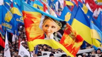 A flag with an image of Yulia Tymoshenko is carried by protesters attending a rally to support EU integration in central Kiev November 24, 2013. Tens of thousands of supporters of Ukraine's European integration flooded central Kiev on Sunday to protest against the government's decision to drop plans to sign a landmark deal with the European Union in Vilnius on November 29 and to revive talks on ties with Russia. REUTERS/Gleb Garanich (UKRAINE - Tags: POLITICS CIVIL UNREST)