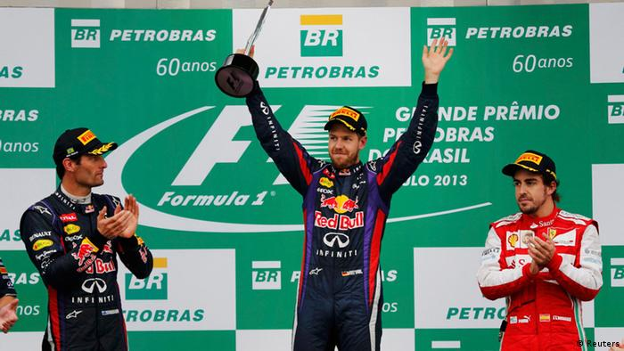Red Bull Formula One driver Sebastian Vettel of Germany celebrates after winning the Brazilian F1 Grand Prix at the Interlagos circuit in Sao Paulo November 24, 2013. REUTERS/Nacho Doce (BRAZIL - Tags: SPORT MOTORSPORT F1)