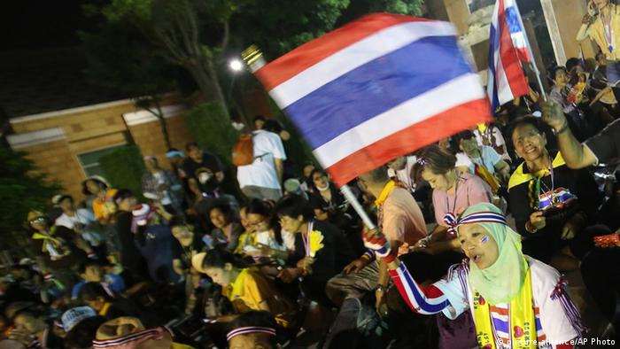 Anti-government protesters, with Thai national flags, gather inside the compound of the Foreign Ministry in Bangkok, Thailand, Monday, Nov. 25, 2013. Anti-government demonstrators in Thailand occupied parts of two government ministries, the finance and foreign ministries, on Monday, turning up the pressure in their offensive against the administration of Prime Minister Yingluck Shinawatra. (AP Photo/Sakchai Lalit) pixel