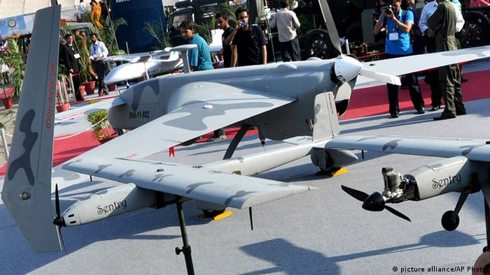 In this Nov. 15, 2012, file photo, visitors look at Pakistan-made unmanned aircraft at defense exhibition in Karachi (Photo: AP Photo/Shakil Adil, File)