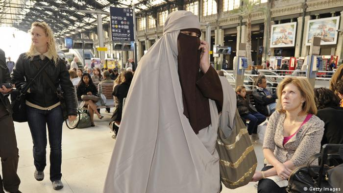 A veiled woman walks through a railway station ANNE-CHRISTINE POUJOULAT/AFP/Getty Images