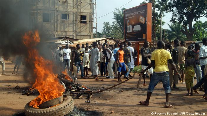 People gather at the Sica-Benzvi square in Bangui as unrest erupt after the assassination of a magistrate the day before.